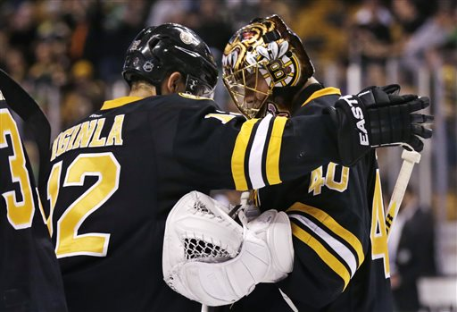 Boston Bruins goalie Tuukka Rask is congratulated by right wing Jarome Iginla after they defeated the Minnesota Wild in Boston on Monday night.