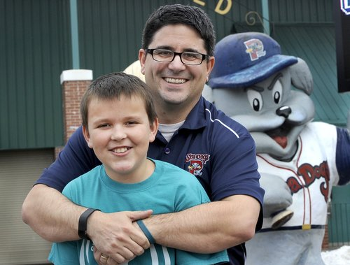 Justin LeBlanc, who animated Slugger for the first three years of the franchise's existence in Portland, will walk with the Sea Dogs mascot from Fenway to Hadlock to raise funds for children with Tourette's syndrome. With him is son Theo, who has Tourette's.