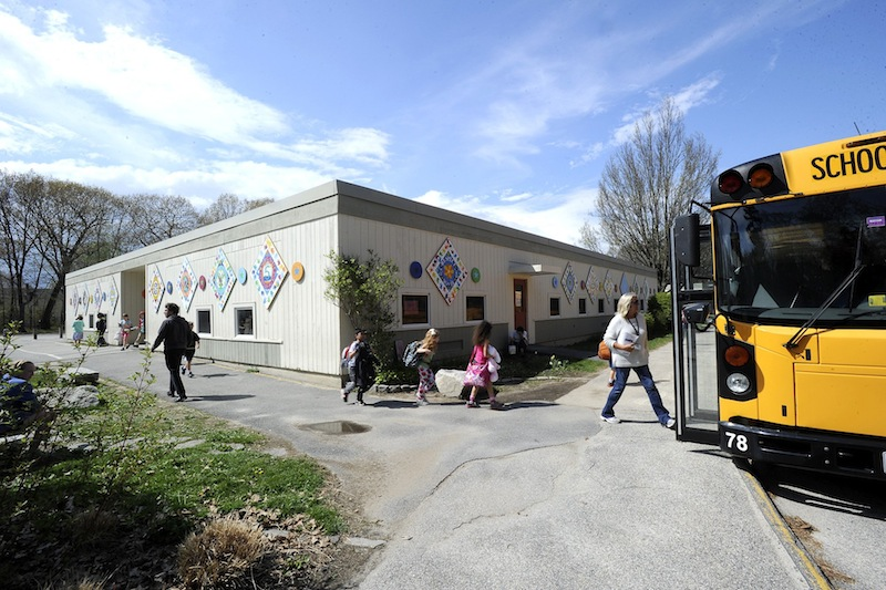 Portland's Hall School, which was damaged by fire two years ago, and two aging high schools in midcoast Maine are guaranteed to receive state aid to build new facilities or renovate their existing buildings.