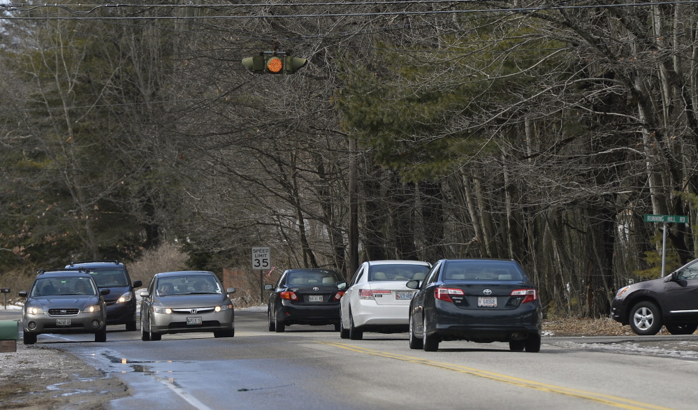 SCARBOROUGH, ME - March 31: A car tries to make a left hand turn onto Running Hill Rd. from Route 114 in Scarborough Monday, March 31, 2014. (Photo by Shawn Patrick Ouellette/Staff Photographer)