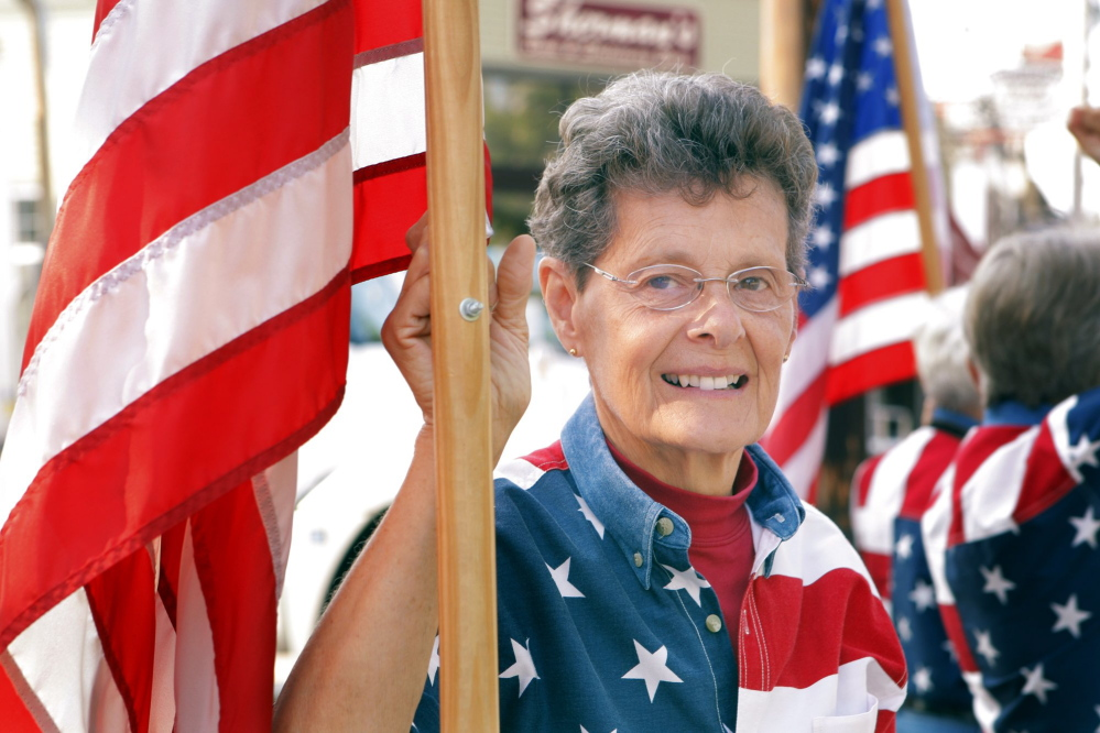 Carmen Footer is one of the Freeport Flag Ladies who have met on Main Street in Freeport every Tuesday since September 11, 2001.