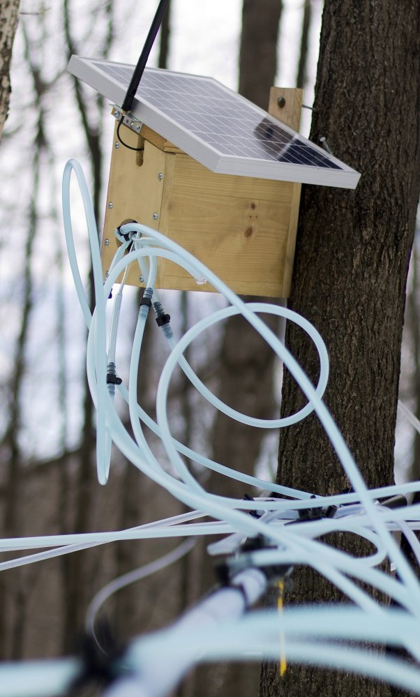 One of Richards' wireless radio units box containing sensors that monitor pressure on sap lines is seen in Milton, Vt.