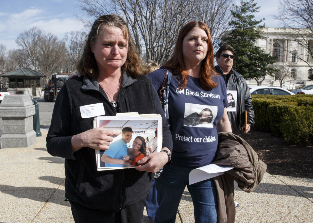Cherie Sharkey, left, weeps for her son Michael Sharkey who died in his used 2006 Chevy Cobalt in Dresden, N.Y., as she walks with Laura Christian, of Harwood, Md., birth mother of Amber Marie Rose, the first reported victim of the General Motors safety defect, on Capitol Hill Tuesday.
