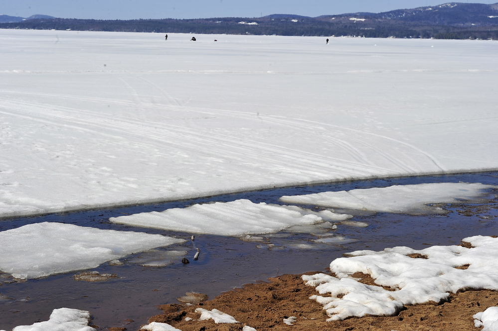 The ice continues to melt along the shore of Sebago Lake, making it harder for ice fishermen to get off the ice to shore.