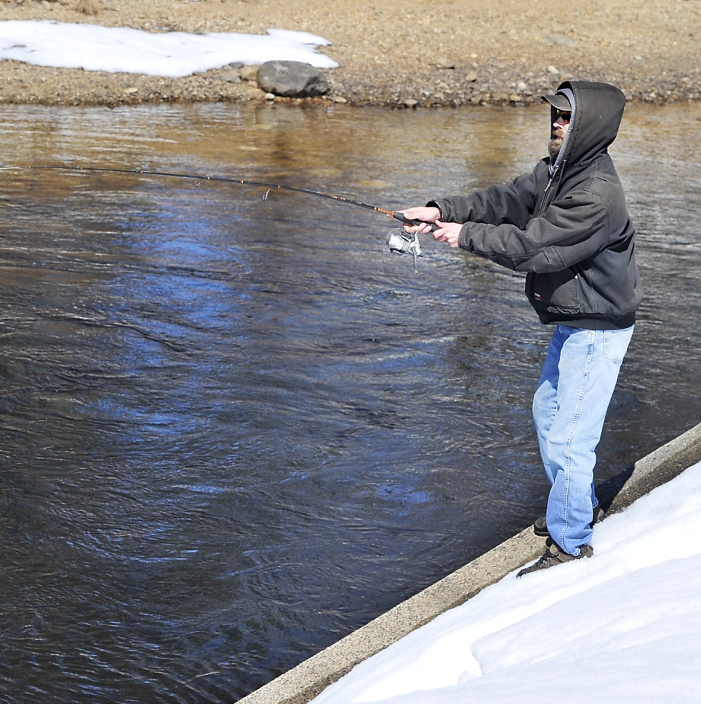 Ed Merrill of Naples casts at Songo Locks on Sebago Lake on the traditional first day of open-water fishing season.