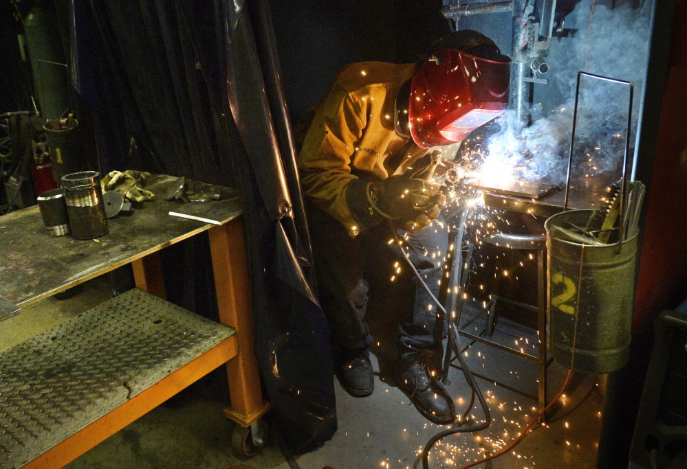 Luke Buss welds Tuesday during class at SMCC. Buss, 20, of Manchester, Vt., expects to graduate in May with an associate degree and has lined up an internship at a company near his hometown.