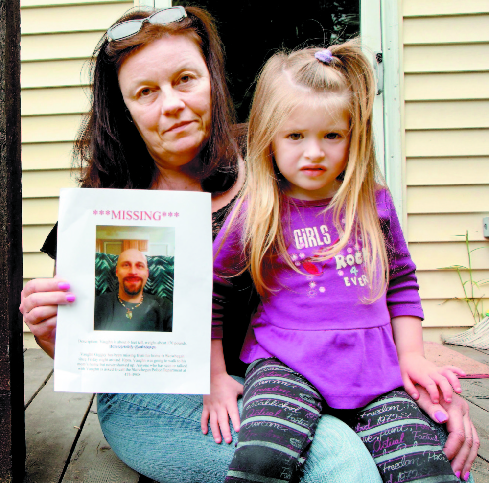 Rosanne Dubay, mother of Vaughn Giggey, displays a photo of him after he disappeared in August while walking from his Skowhegan home to hers. With her is Giggey's niece, Arrienna Bowring. His body was found later in Currier Brook about a quarter-mile from his home on Main Street.