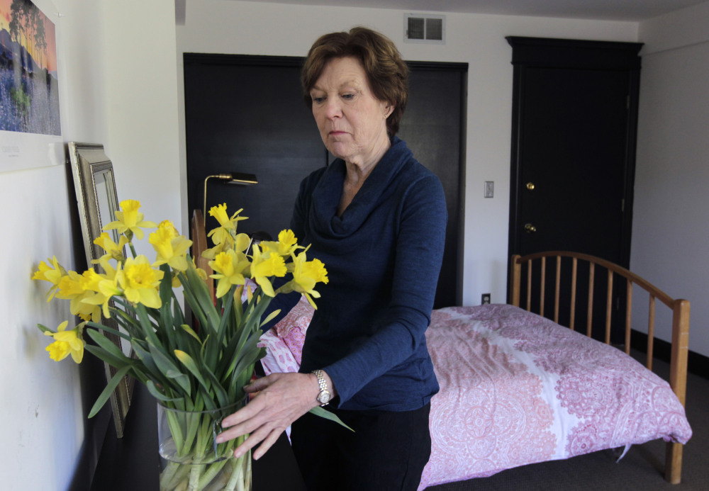 Lorraine Rorke Bader arranges fresh flowers recently at her San Francisco home before an overnight guest arrives. Bader rents out the room, with a three-night minimum stay, for $120 a day using the Airbnb online home rental service.