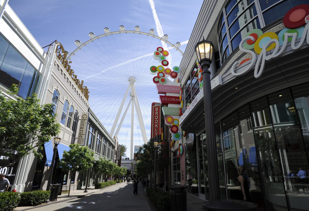 The Las Vegas High Roller towers over the shops at The LINQ. From a distance, the motion of the wheel is nearly imperceptible.
