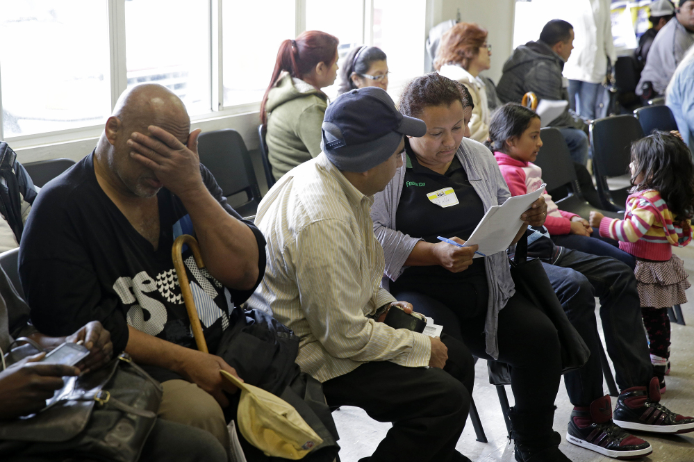 Applicants wait to be called during a health care enrollment event at the Bay Area Rescue Mission in Richmond, Calif., on Monday. A few routes remain open for those who missed the health care law's big enrollment deadline.