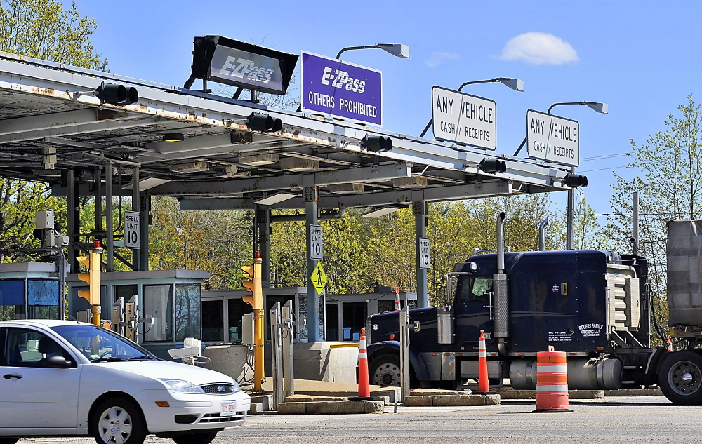 Vehicles pass through a toll booth in Maine. The use of E-ZPass in Northeast states makes it easier to track down toll cheats.