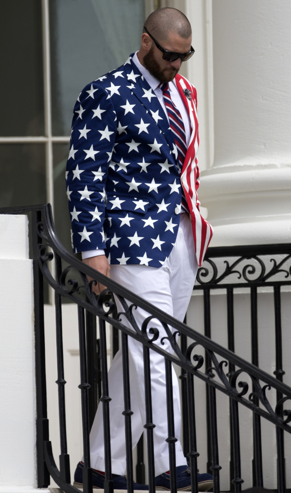 Jonny Gomes of the Red Sox arrives at the White House sporting an American flag blazer. The team was invited after winning the World Series three times in 10 seasons.