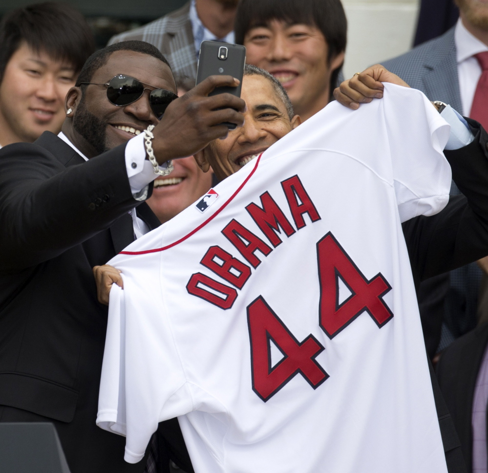 After presenting President Obama with a Red Sox jersey, David Ortiz of the Boston Red Sox takes a selfie of the two of them, which he promptly tweeted. The Red Sox visited the White House on Tuesday.