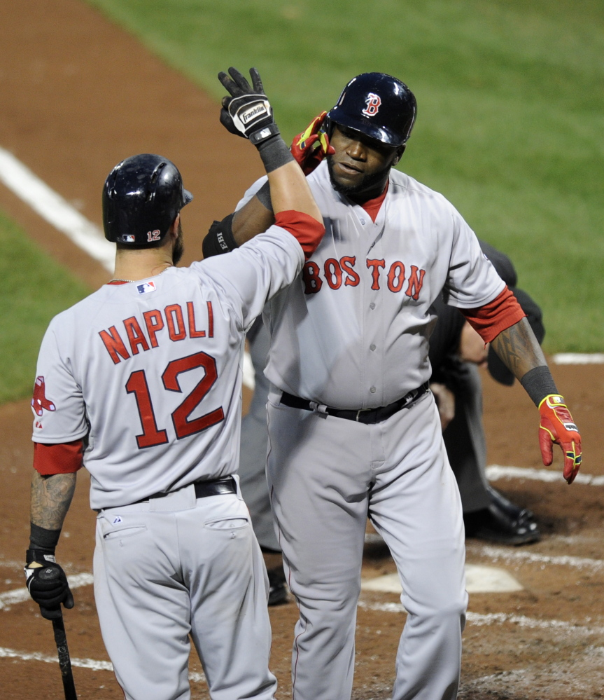 Boston Red Sox designated hitter David Ortiz, right, celebrates his two-run home run with Mike Napoli during the third inning of Wednesday's game against the Baltimore Orioles.