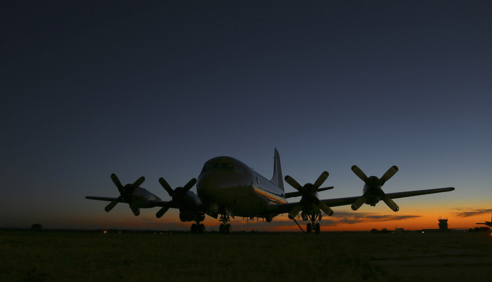 Royal New Zealand Air Force's P-3 Orion sits on the tarmac at RAAF base Peace in Perth, Australia, Wednesday, April 2, 2014. Ten planes and nine ships resume the search for the missing Malaysia Airlines Flight MH370 in the southern Indian Ocean.