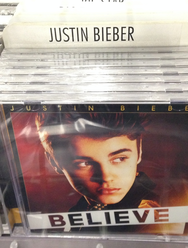 Musician and artist Paz says he's planted 5,000 copies of his own CD in what appears to be Bieber's packaging.