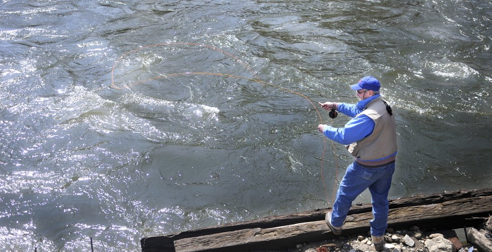 OPEN WATER: State and federal officials met Wednesday to discuss the flood risk of the Kennebec River, where Tom Bouchard of Farmingdale fished at the confluence of Cobbossee Stream in Gardiner.