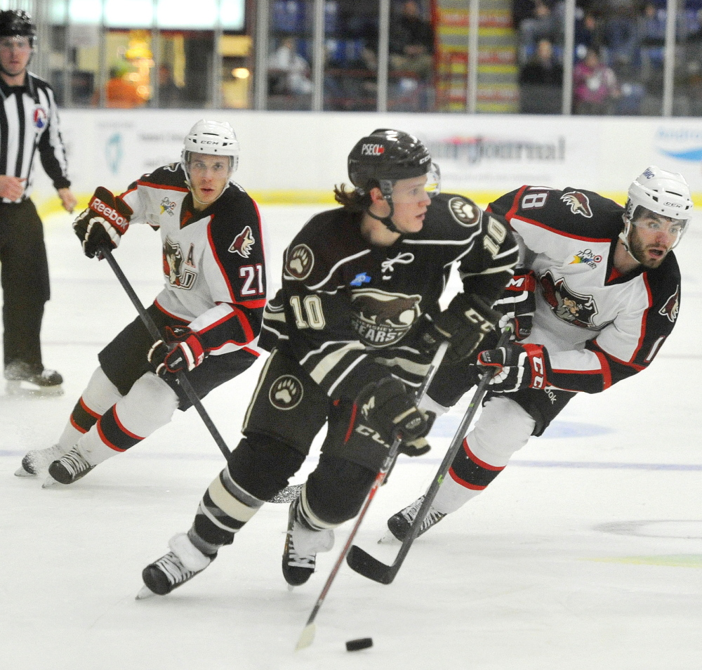 Hershey's Dustin Gazley stickhandles past Portland's Andy Miele, left, and Jordan Martinook during the Bears' victory Wednesday night at the Colisee in Lewiston.