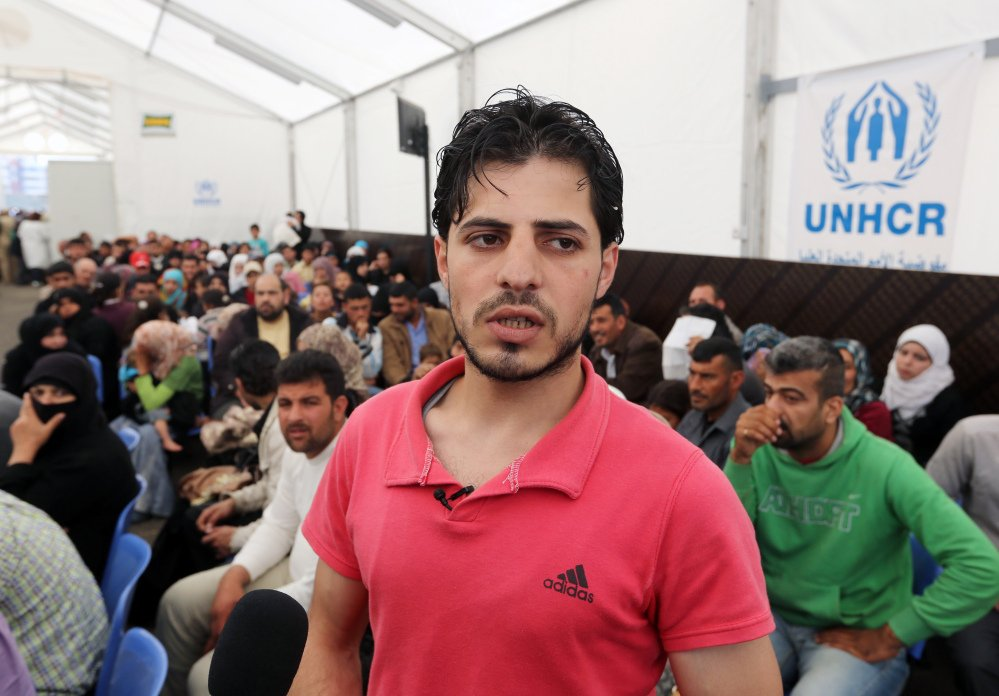 Syrian refugee Yahya speaks to journalists at the United Nations High Commissioner for Refugees registration center in the northern city of Tripoli, Lebanon, on Thursday. The teenager from central Syria became the 1 millionth Syrian refugee to register in Lebanon.