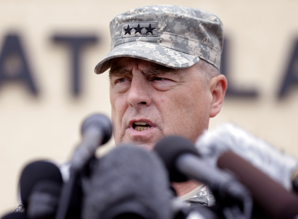 Army Secretary John M. McHugh, left, and Army Chief of Staff Gen Raymond Odierno update members of the Senate Armed Services Committee Thursday about the deadly shooting rampage by a soldier at Fort Hood in Texas.