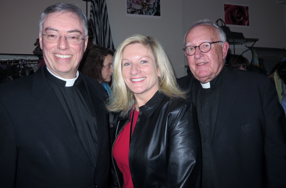 "Father Marc Caron with Deb Coppinger, parish secretary at Parish of the Holy Eucharist in Yarmouth, and Monsignor Charles Murphy at the Maine Jewish Film Festival opening reception before the showing of ""The Jewish Cardinal"" at the Nickelodeon."