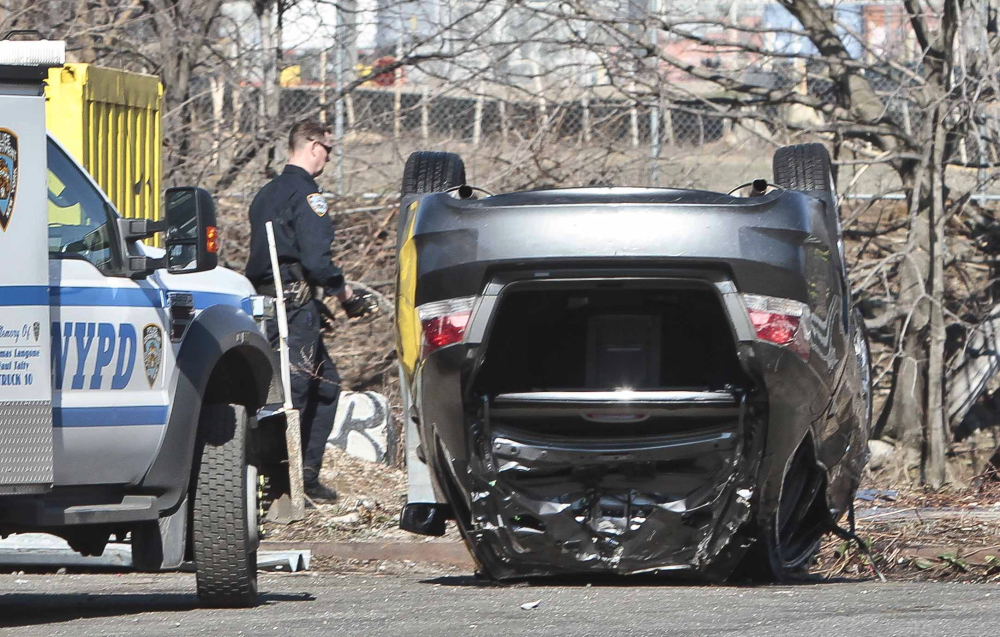 Police recover a 2009 Honda Accord from the Steinway Creek on Saturday in New York. The driver drove the car off a dead-end street in a desolate industrial area. The car flipped over a wooden curb into the East River inlet, killing four passengers.