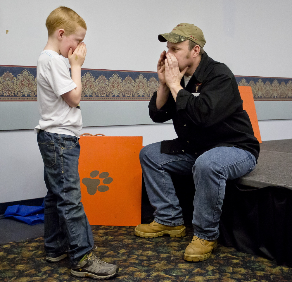 Eight-year-old Owen Heseltine of Chesterville, tutored by Lee Schanz Jr. of the Maine Professional Guides Association last week at the Augusta Civic Center, already is showing signs of being a master moose caller in the making.