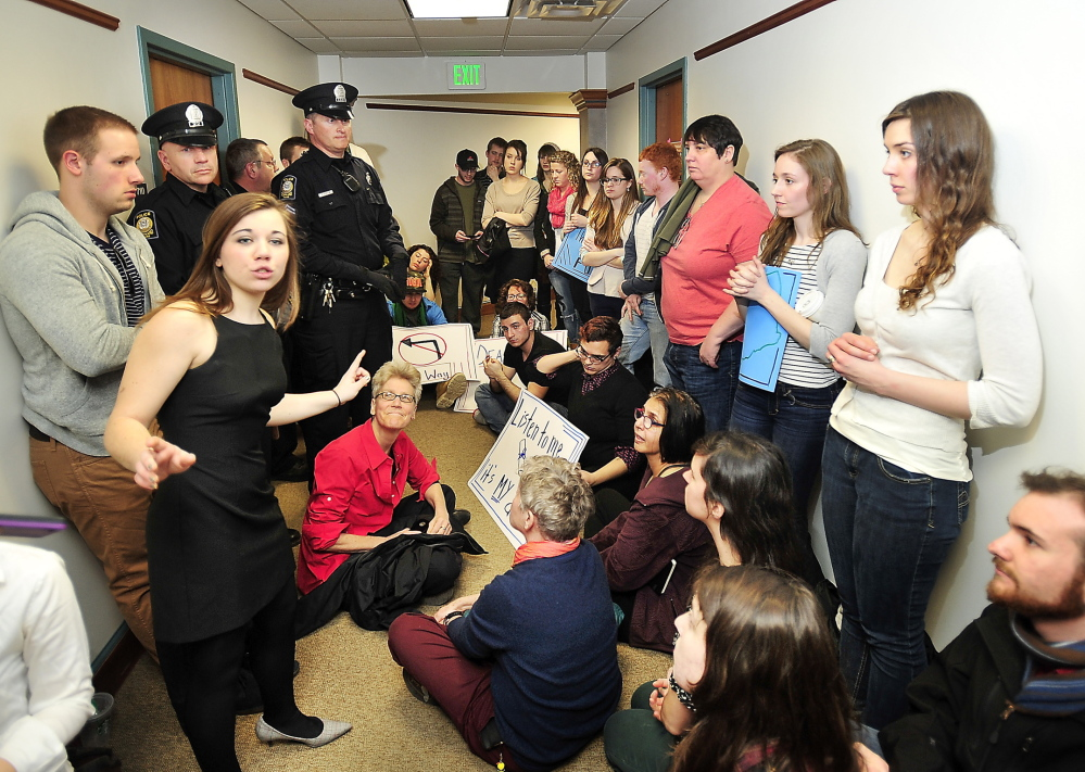 Brittany Hill, a fourth-year student at USM majoring in political science and economics, speaks her mind as students and faculty protest outside offices of the USM provost in March.