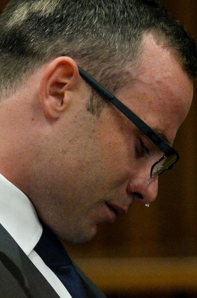 Oscar Pistorius cries in court on March 24 as he listens to evidence being given about his girlfriend's death.