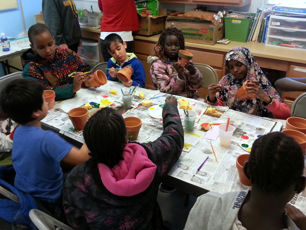 Kids at the Riverton Park Boys and Girls Club prepare painted pots during a recent Kids in the Kitchen event led by Junior League of Portland volunteers.