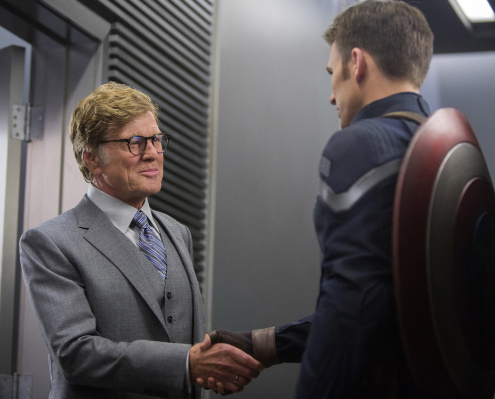 "Chris Evans, right, and Robert Redford in a scene from ""Captain America: The Winter Soldier."" The film debuted in the U.S. with a take of $96.2 million."