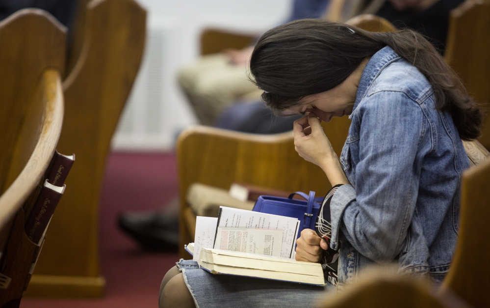 Kathy Abad, a military wife, prays for the victims and families affected by the Fort Hood shooting during a service Sunday at the Tabernacle Baptist Church in Killeen, Texas.