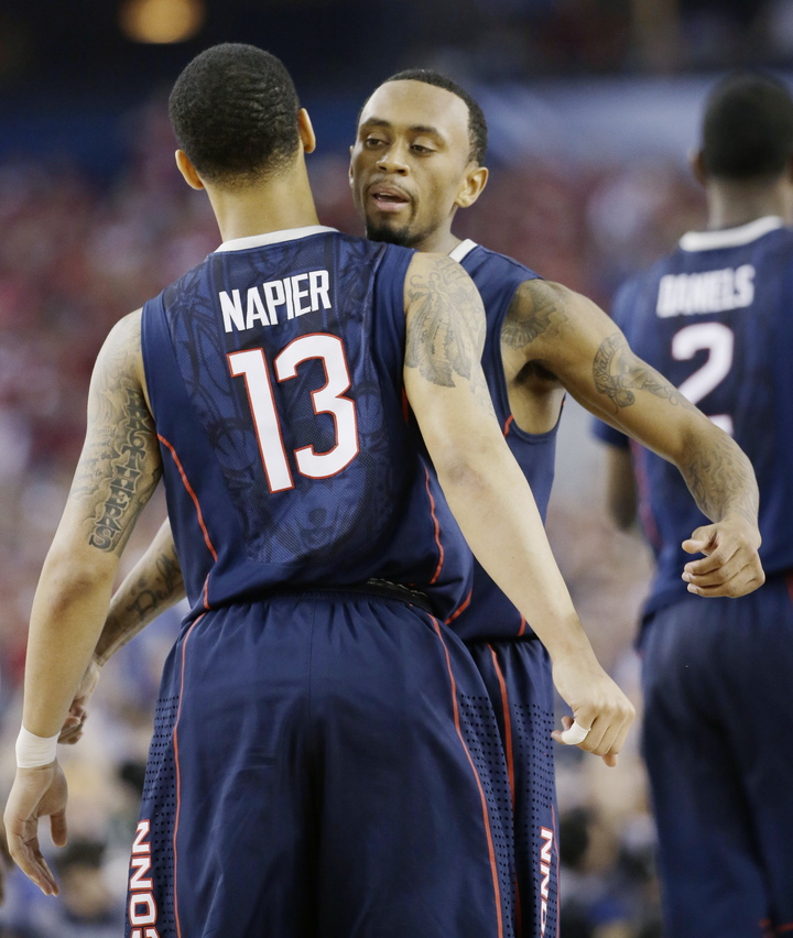 Connecticut guard Shabazz Napier (13) and guard Ryan Boatright celebrate during the second half of the NCAA Final Four Saturday in Arlington, Texas.