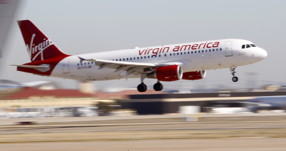 In this Dec. 1, 2010 file photo, Virgin America's inaugural flight between Los Angeles an Dallas Fort Worth International Airport comes in for a landing in Grapevine, Texas. Virgin America topped the latest ratings of airlines.