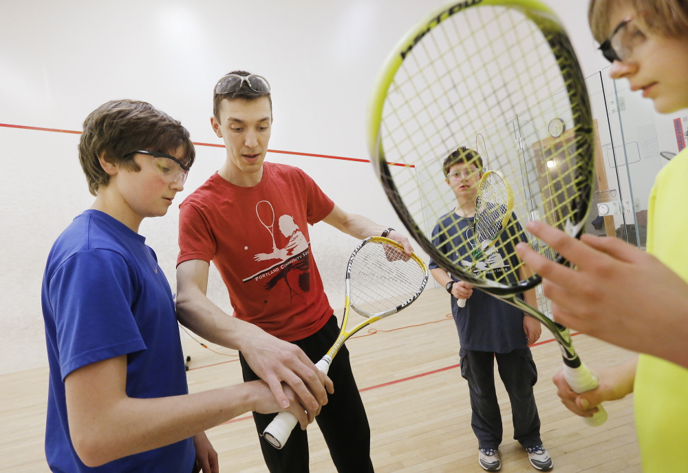 Barrett Takesian trains middle school students during a squash practice at the Portland YMCA.
