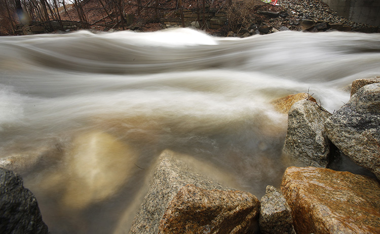 Water rushes over rocks in the Mousam River in Kennebunk on Tuesday. The National Weather Service has issued a flood watch because heavy rains overnight are causing rivers to swell.