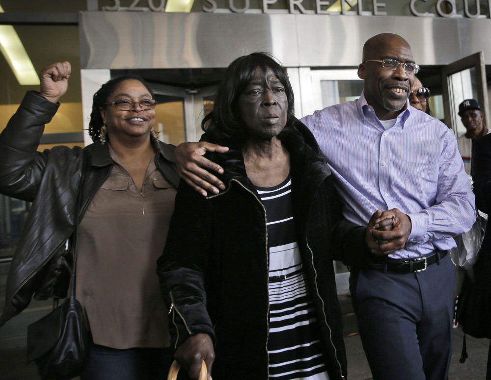 Jonathan Fleming exits the courthouse with his mother, Patricia Fleming, second from right, in New York on Tuesday after he spent nearly 25 years in prison.
