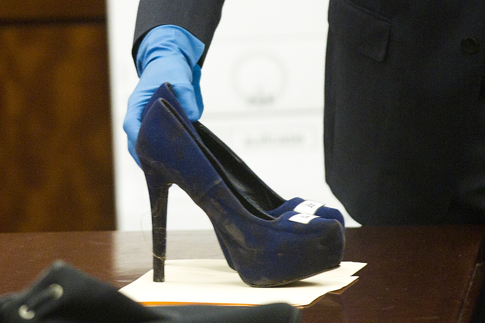 Prosecutor John Jordan sets down a stiletto shoe entered into evidence during the trial against Ana Lilia Trujillo last week in Houston.