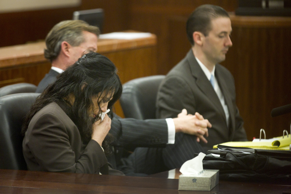 Ana Lilia Trujillo, left, reacts to hearing a 911 call during her trial last week in Houston.