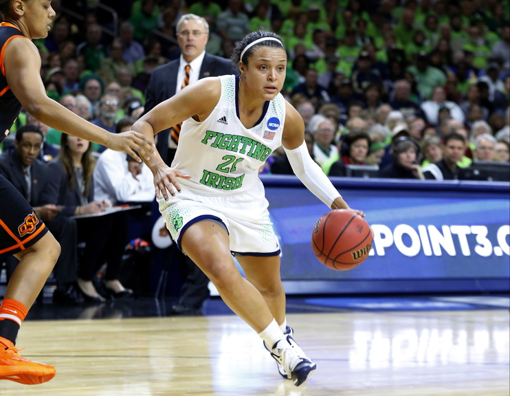 Notre Dame guard Kayla McBride (21) drives against Oklahoma State during the first half of their NCAA women's college basketball tournament regional semifinal at the Purcell Pavilion in South Bend, Ind.