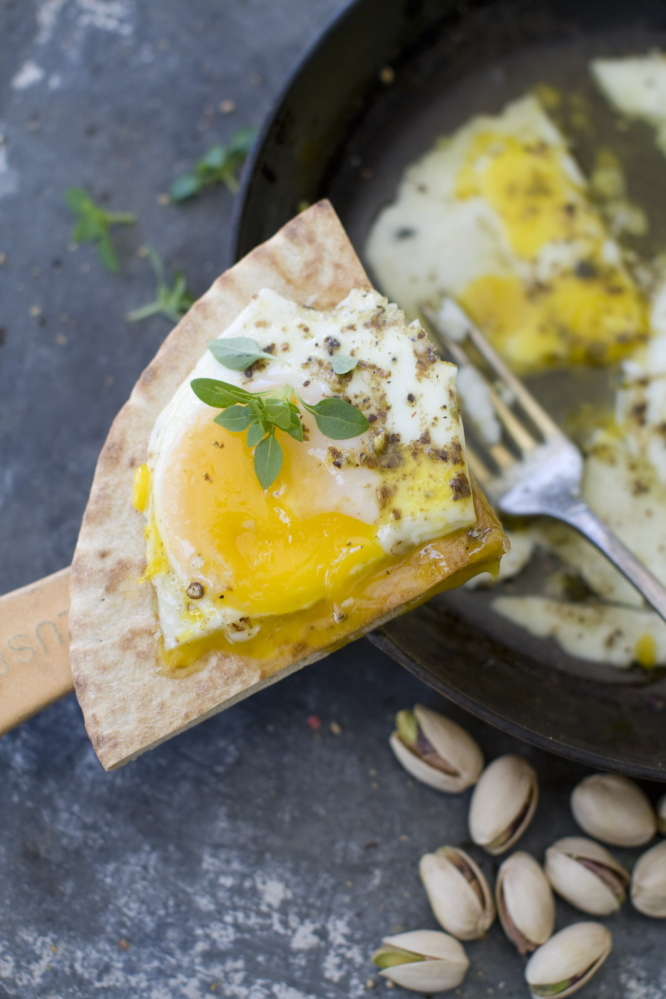 Oven eggs with olive oil and dukkah, an Egyptian seasoning made from ground spices and nuts, go well with any bread.