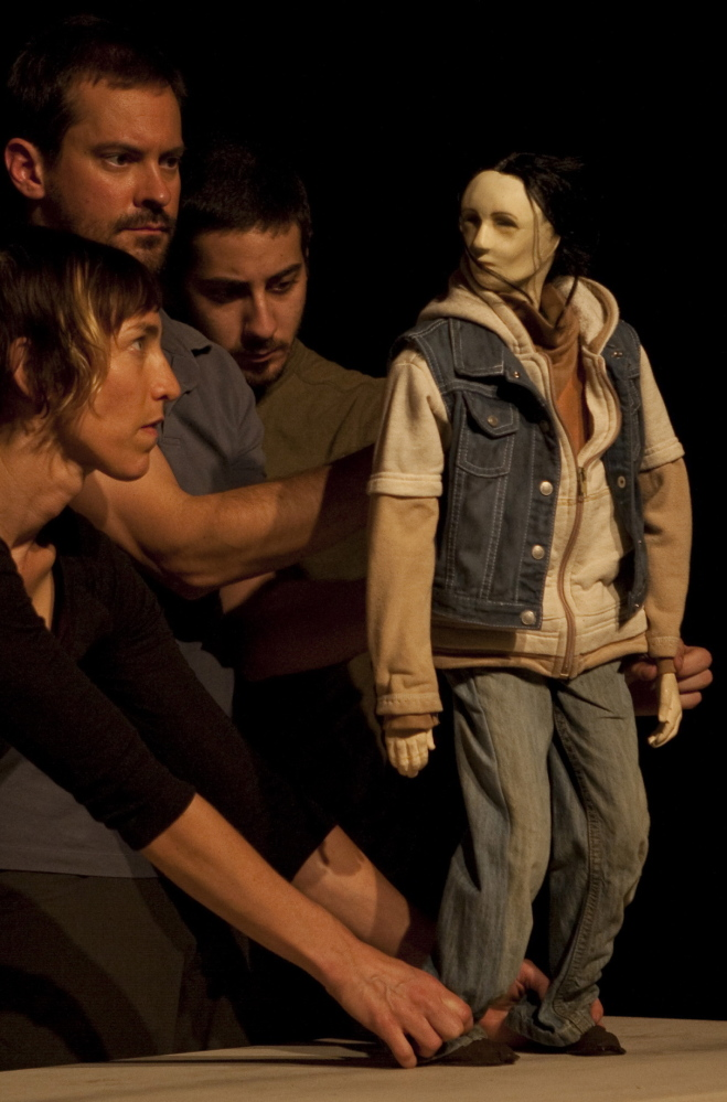 'Who's Hungry' cast members manipulate a puppet. There is also dance in the production, which uses art as activism to find solutions to food insecurity.