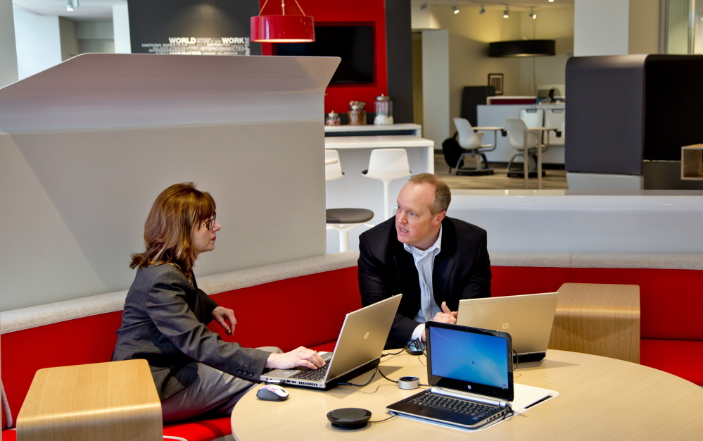 Suzanne Ludlow and Dan Nutting work in Red Thread, an office furniture business on the first floor of One City Center in Portland, which recently moved from Westbrook.