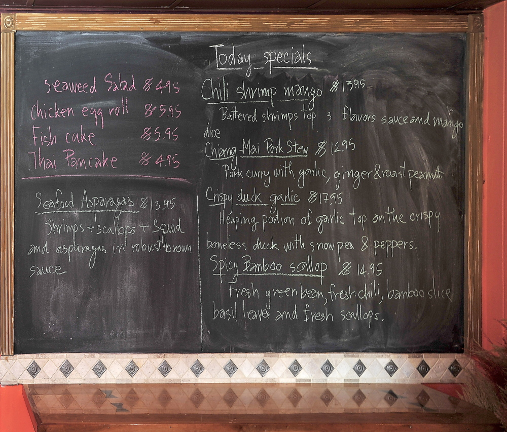 Chaba Thai's daily specials are posted on the blackboard at the entrance to the Scarborough restaurant. The specials include two choices from an unusual variety of side dishes.