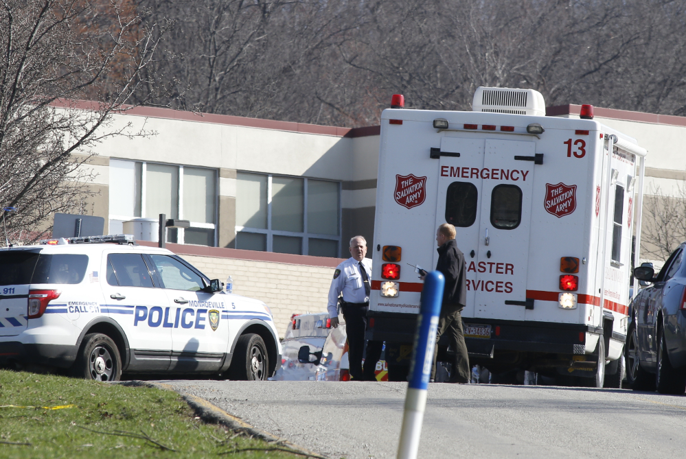 Emergency responders gather in the parking lot of the high school on the campus of the Franklin Regional School District where several people were stabbed at Franklin Regional High School on Wednesday, April 9, 2014, in Murrysville, Pa., near Pittsburgh. The suspect, a male student, was taken into custody and being questioned.