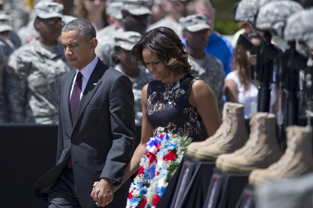 President Obama and first lady Michelle Obama arrive for a memorial ceremony Wednesday at Fort Hood, Texas.