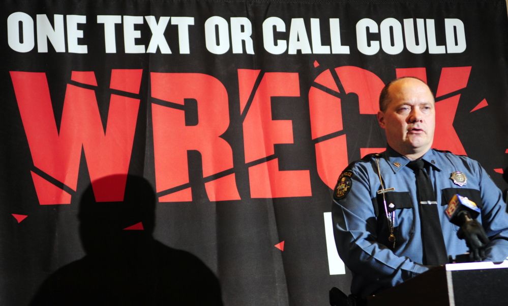 cracking down: Maine State Police Trooper Duane Doughty talks about distracted driving during a news conference on Thursday in Augusta.