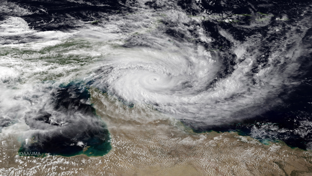 Category 5 tropical cyclone Ita is seen approaching the far north Queensland coast of Australia Thursday in this NOAA satellite image.