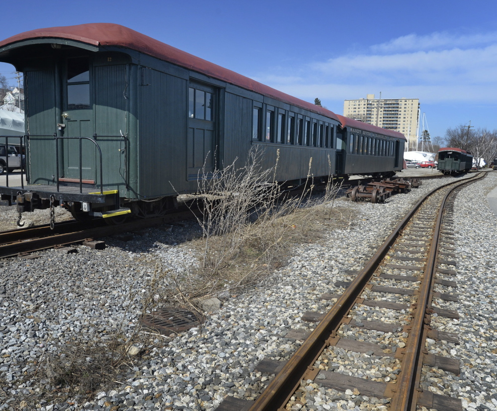 Train cars are stored Thursday on Maine Narrow Gauge Railroad tracks in Portland. Most of the operations are scheduled to move to Gray in 2016, but rides may be offered in Portland until 2023.