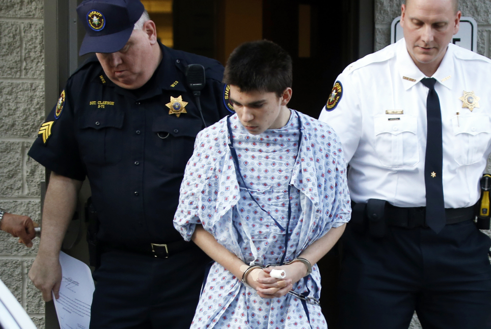 Alex Hribal, the suspect in the stabbings at the Franklin Regional High School near Pittsburgh, is taken from a district magistrate after he was arraigned on charges in the attack on Wednesday in Export, Pa.